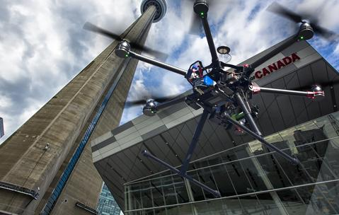 A flying drone in the skies of metro